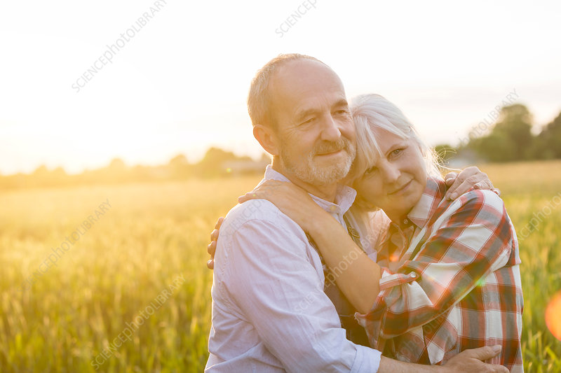 Affectionate serene senior couple hugging