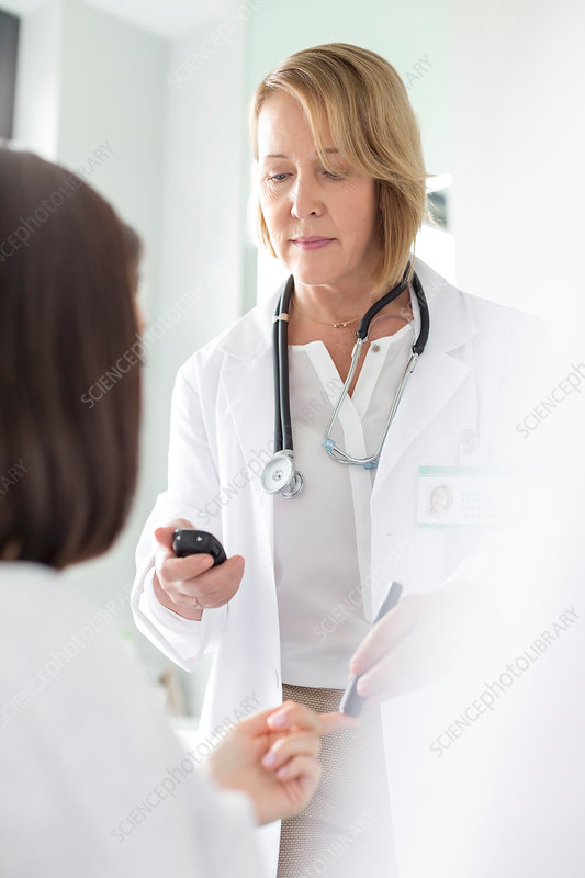 Doctor testing patient blood sugar