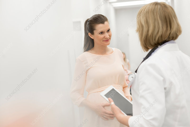 Doctor with digital tablet talking