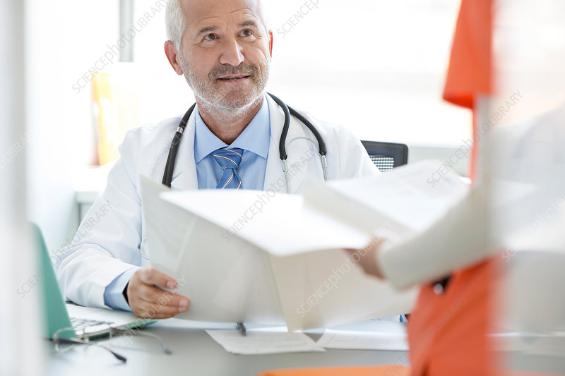 Doctor and nurse reviewing medical record