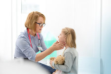 Pediatrician checking patient's glands