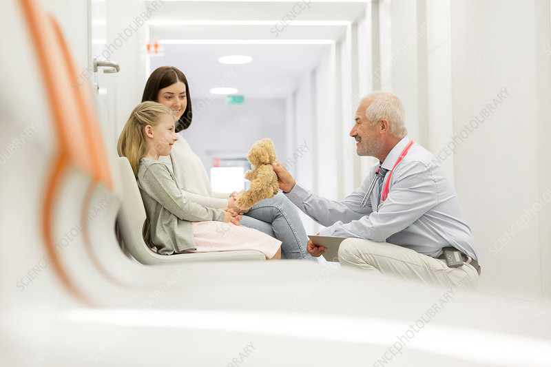 Doctor talking to girl patient