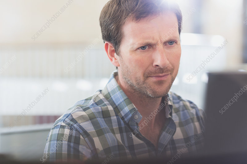 Focused businessman working at computer