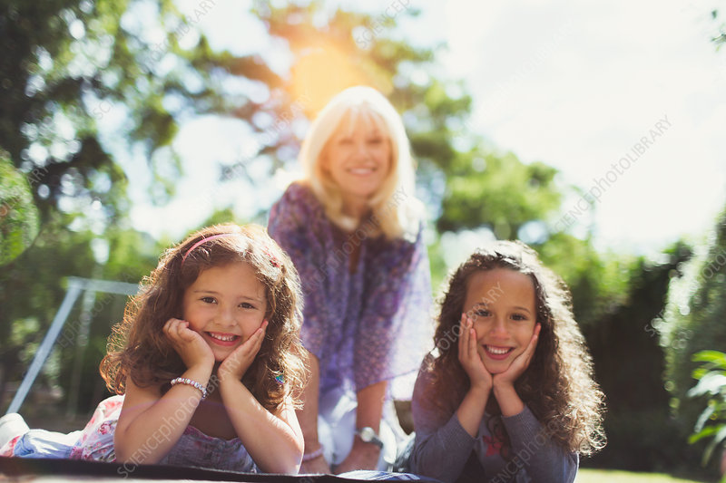 Grandmother with twin granddaughters