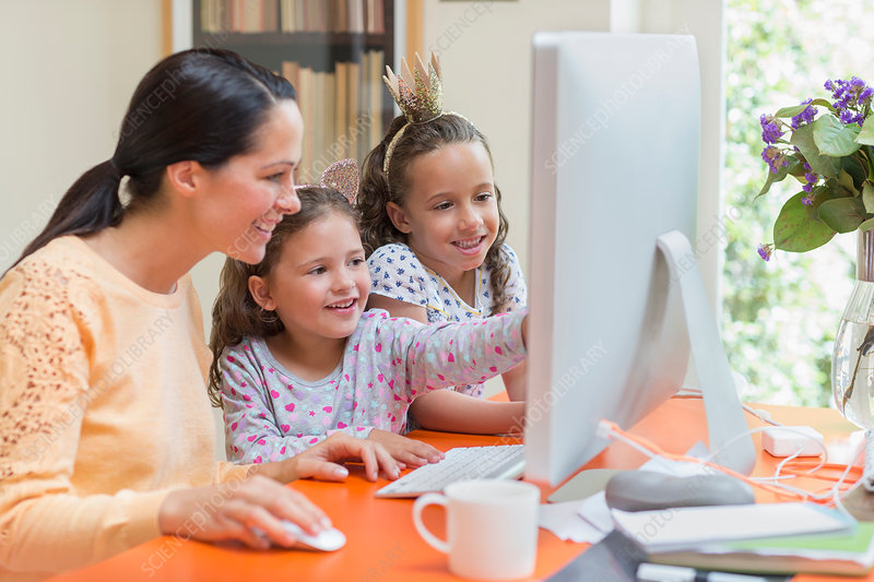 Mother and daughters using computer