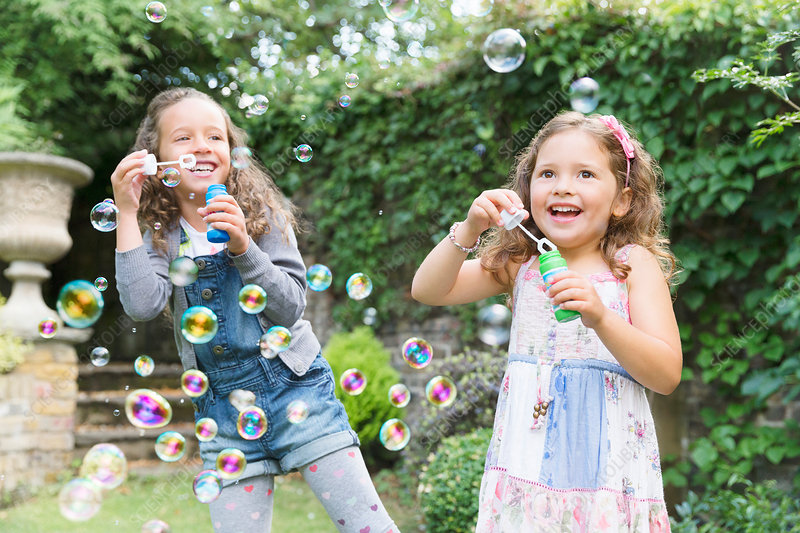 Carefree girls blowing bubbles