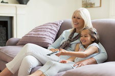 Grandmother and granddaughter on sofa