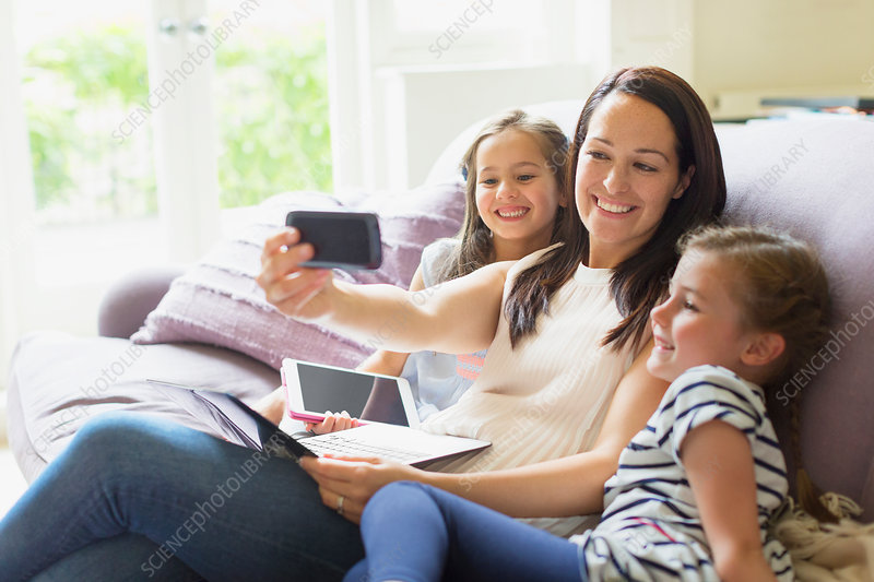 Mother and daughters taking selfie