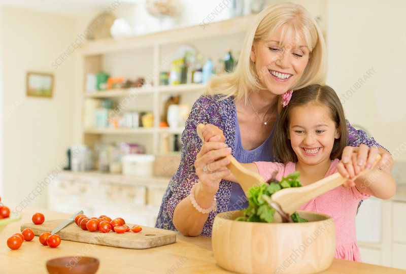 Grandmother and granddaughter with salad