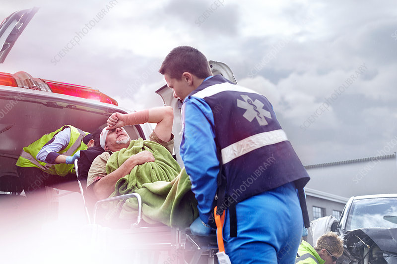 Rescue workers tending to accident victim