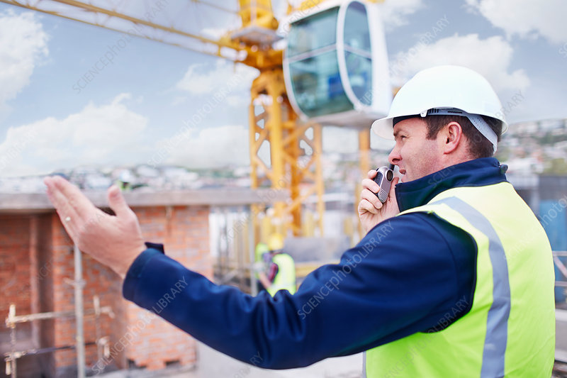 Construction worker with walkie-talkie