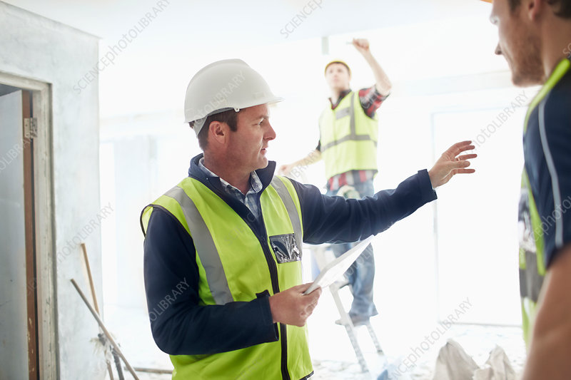 Foreman gesturing to construction worker