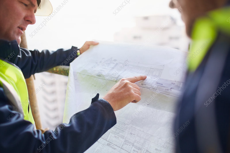 Engineers discussing blueprints