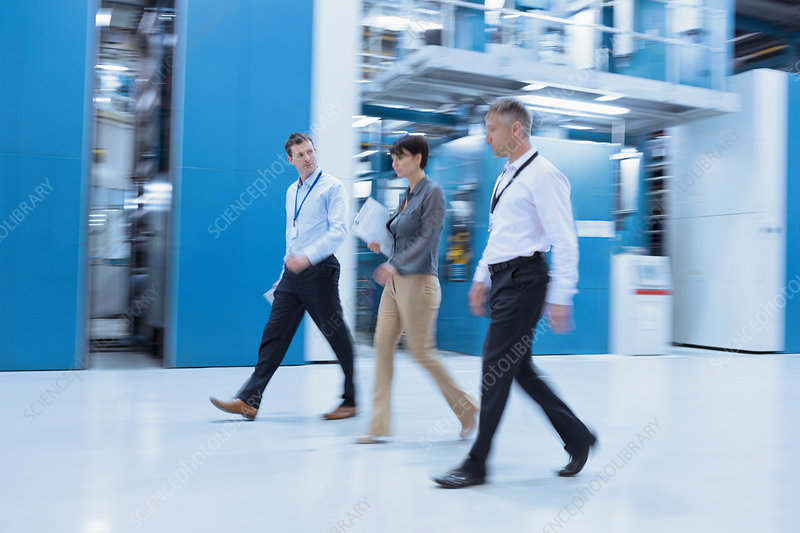 Workers walking in factory