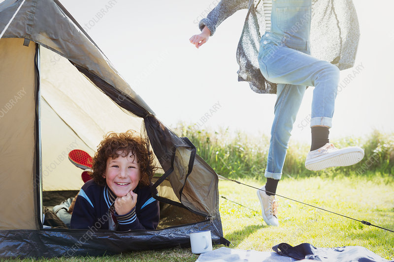 Portrait smiling boy inside tent