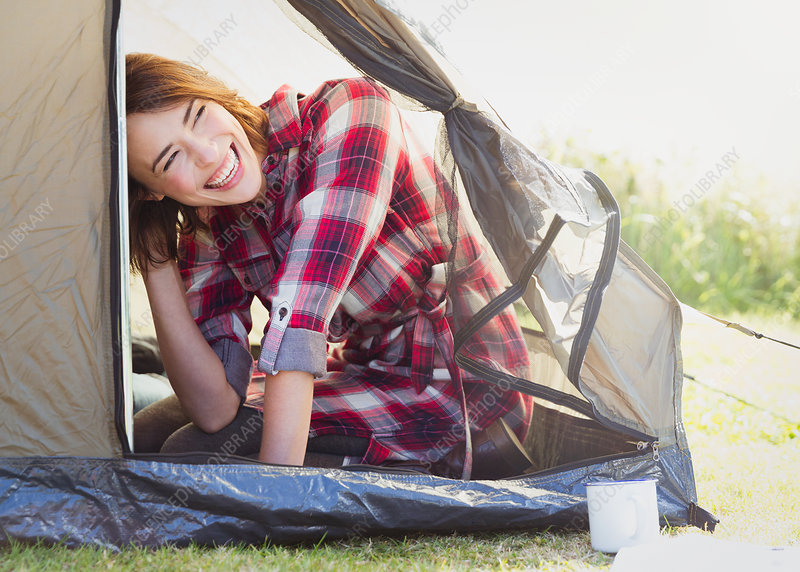 Smiling woman inside tent