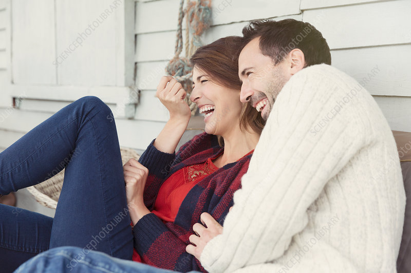 Laughing couple on patio