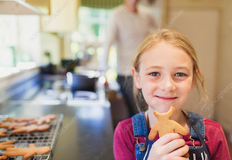 Girl eating gingerbread cookie