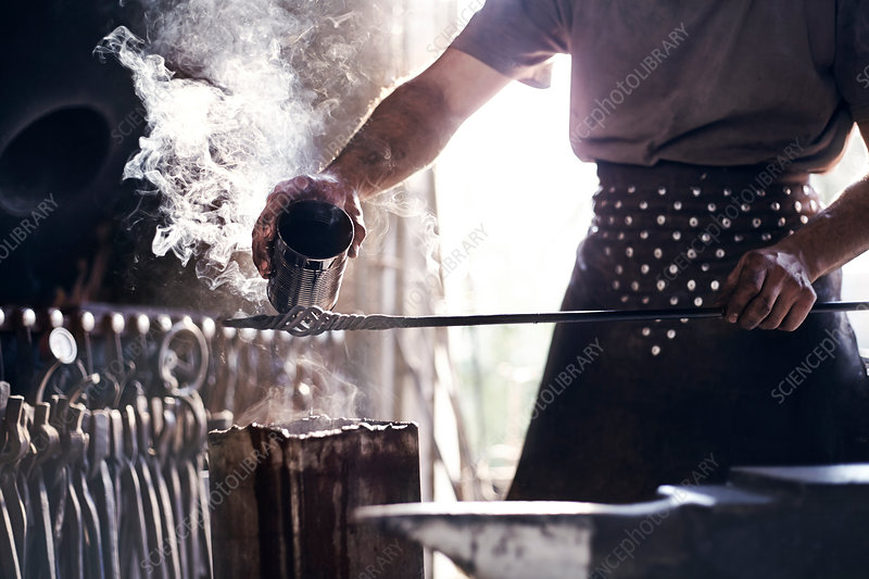 Blacksmith pouring hot liquid