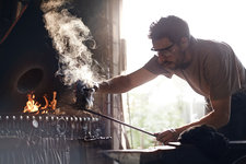 Blacksmith shaping steaming wrought iron