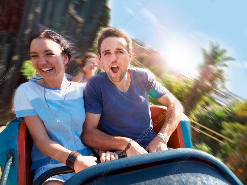 Couple screaming on amusement park ride