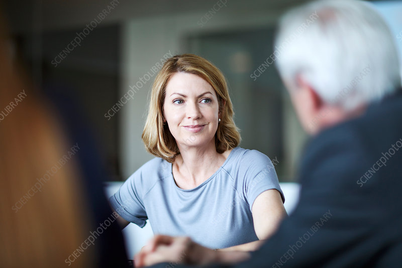 Businesswoman listening to businessman