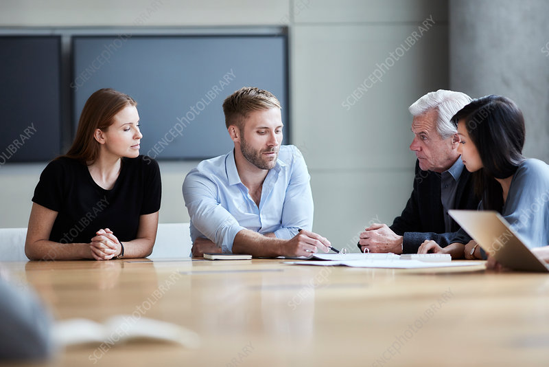 Business people discussing paperwork