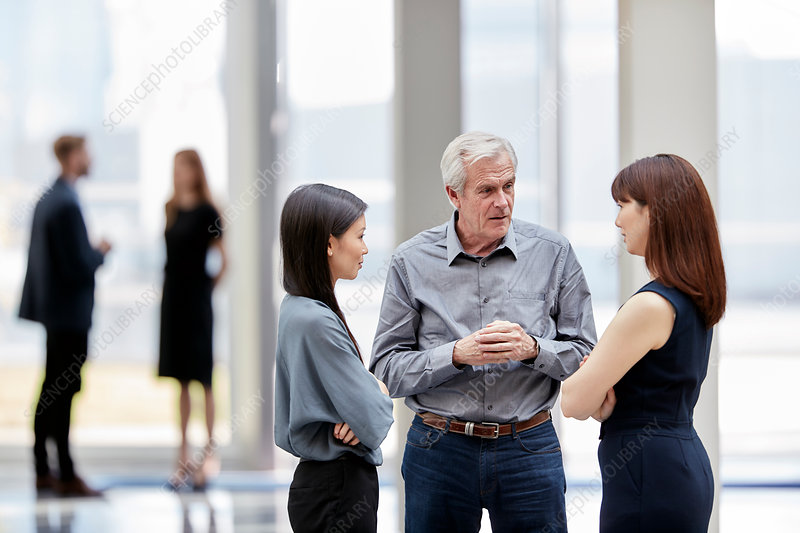 Business people talking in lobby