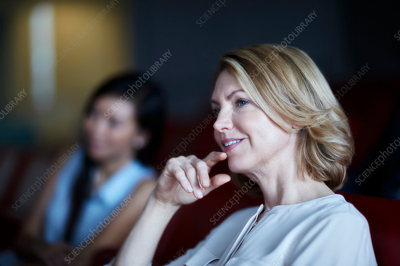 Attentive businesswoman listening