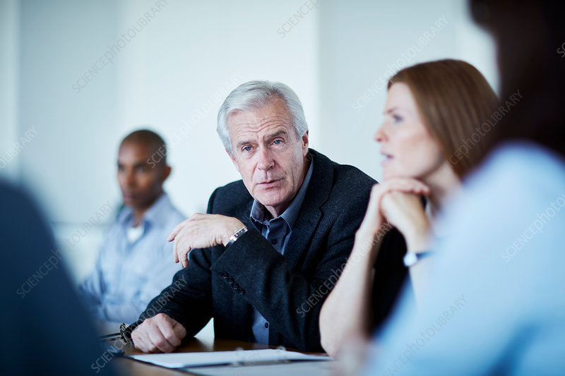 Senior businessman listening in meeting