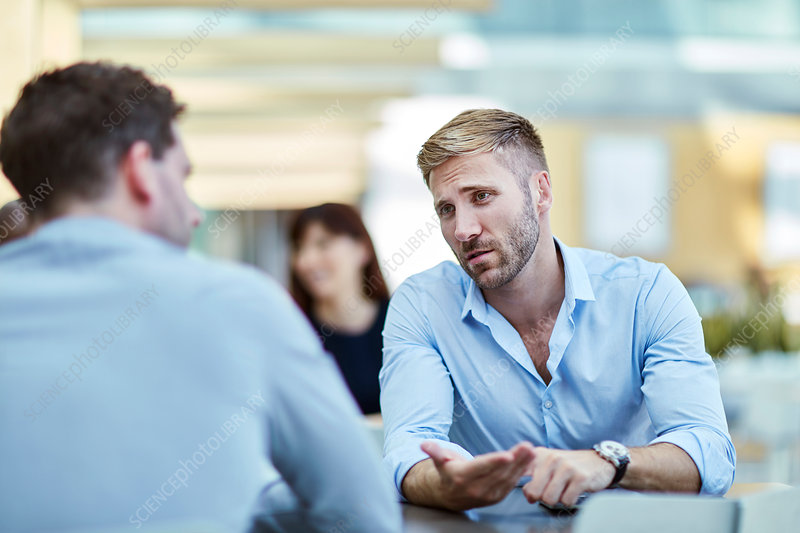 Businessman talking to colleague