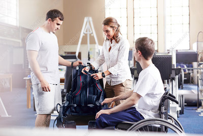 Physical therapists with wheelchair user