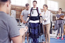 Physical therapists guiding man walking