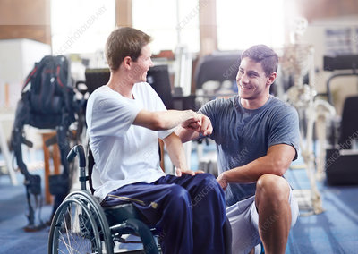 Physiotherapist and man in wheelchair