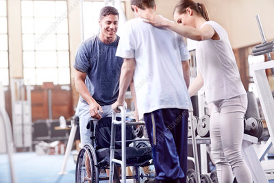 Physiotherapists helping man with walker