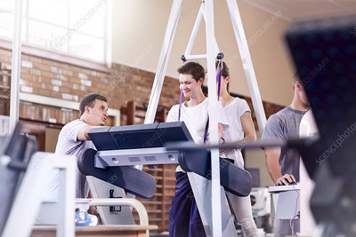 Physiotherapists guiding man on treadmill