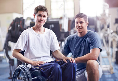 Physical therapist and man in wheelchair