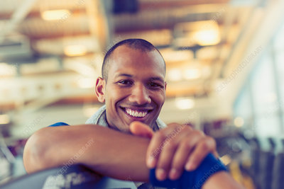 Portrait smiling man at gym