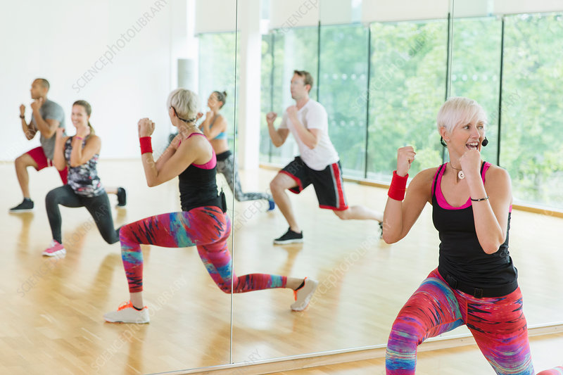 Fitness instructor leading aerobics class