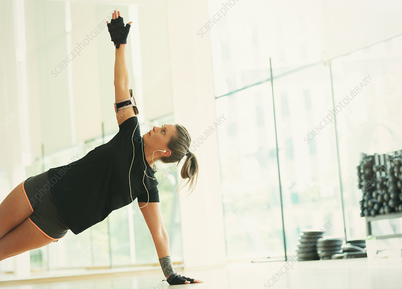 Woman balancing in side plank