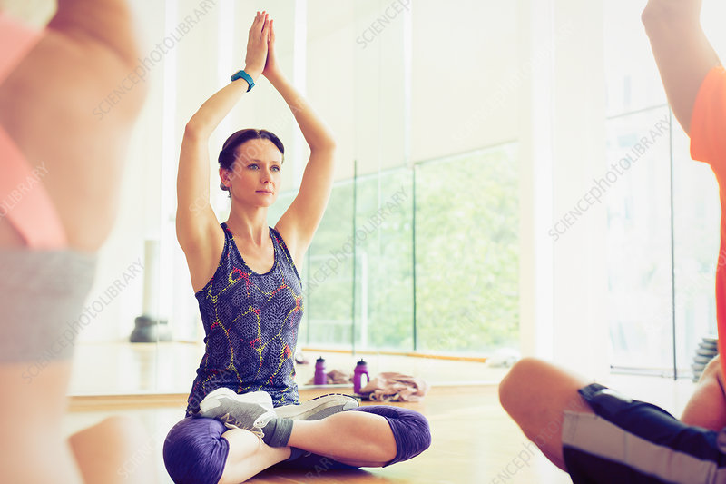 Woman with arms raised in exercise class