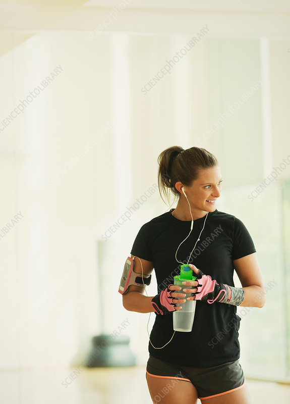 Woman taking a break drinking water