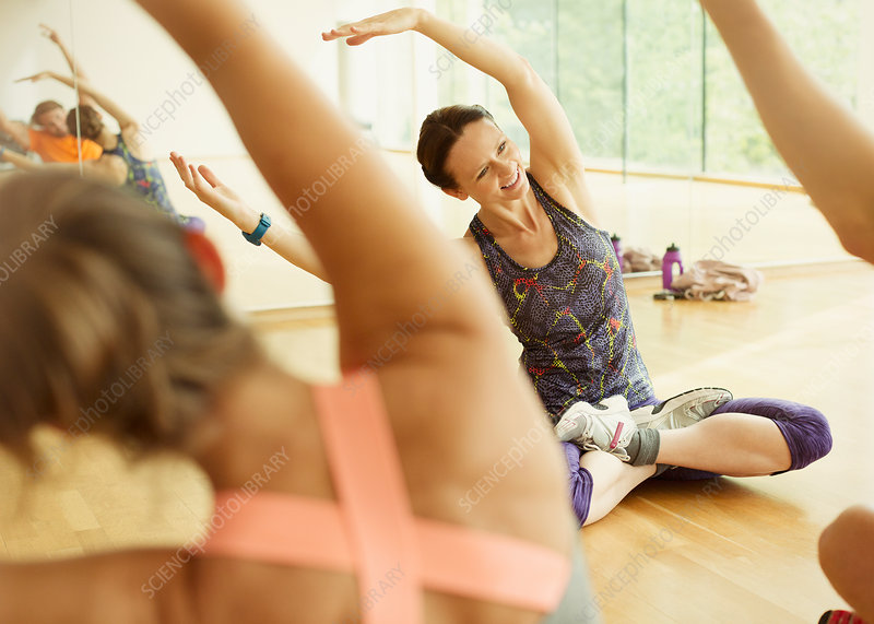 Fitness instructor leading exercise class
