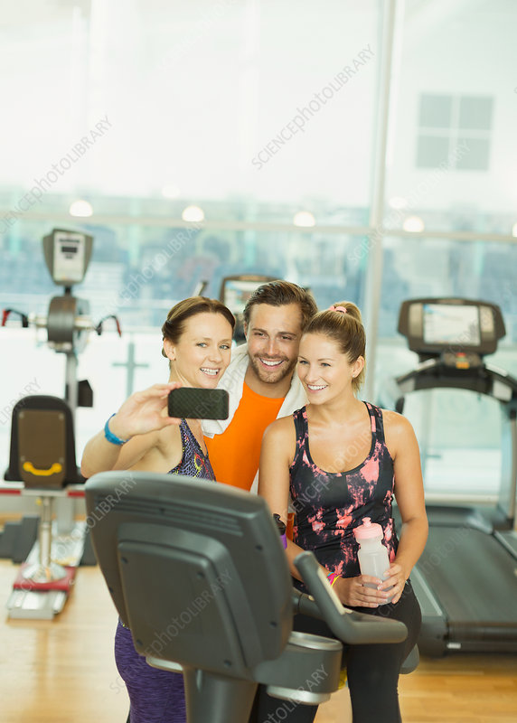 Friends taking selfie at gym