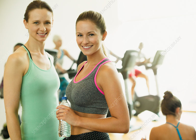 Portrait smiling women resting at gym