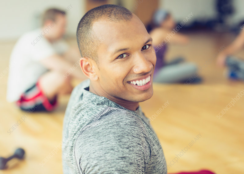 Portrait smiling man in exercise class