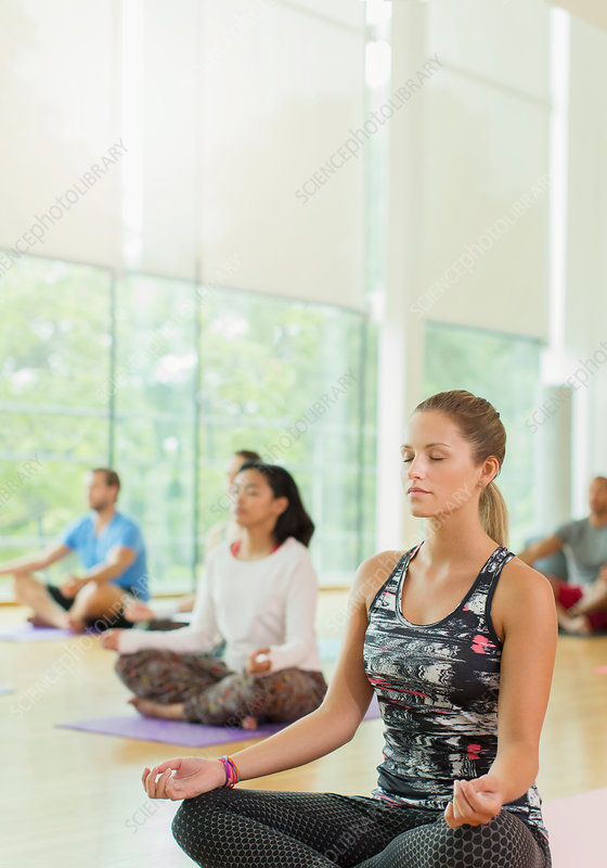 Woman in lotus position with eyes closed