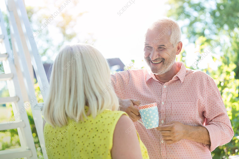 Senior couple drinking coffee outdoors