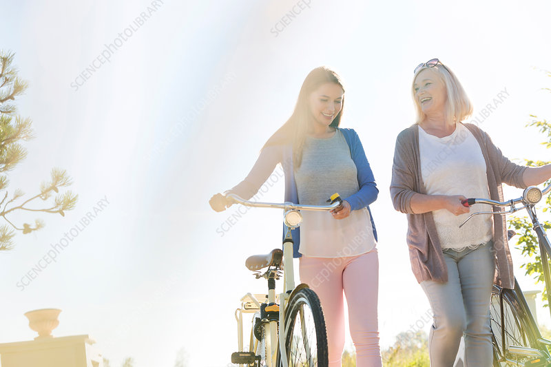 Mother and adult daughter walking