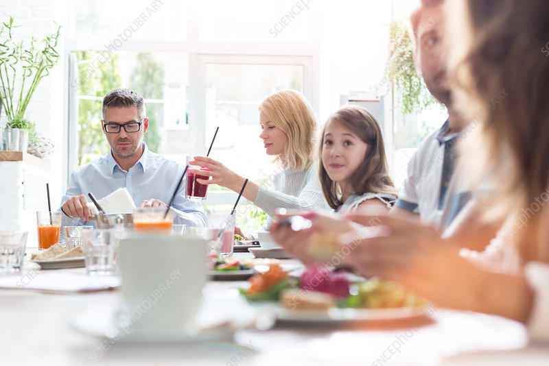 Family eating at cafe table